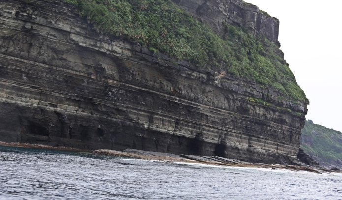 the monument is here exactly 10 meters below the water surface / iseki point . yonaguni