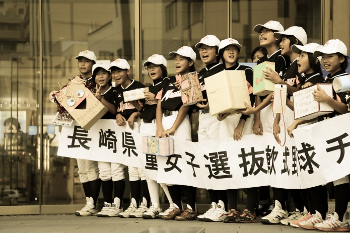 dedicated schoolkids gather for their baseball team