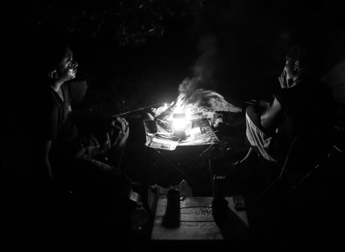 at night around the campfire . talks about philosophy, world politics and which instant noodle-soup is most delicious